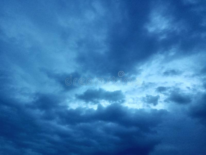 A view of dark blue sky with deep blue clouds stock photography
