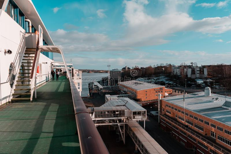 View from the deck of MS Silja Serenade of the Olympic Terminal in Helsinki on a spring day royalty free stock image
