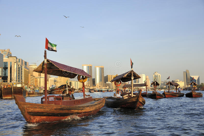 View of Deira quarter from Dubai creek with abra�s or water taxi royalty free stock photography