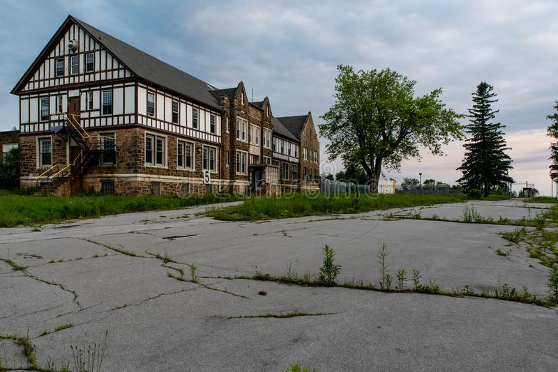 Derelict Administrator Building in Tudor Style Architecture - Abandoned Cresson Penitentiary - Pennsylvania. A view of a derelict administrator building in the royalty free stock photography