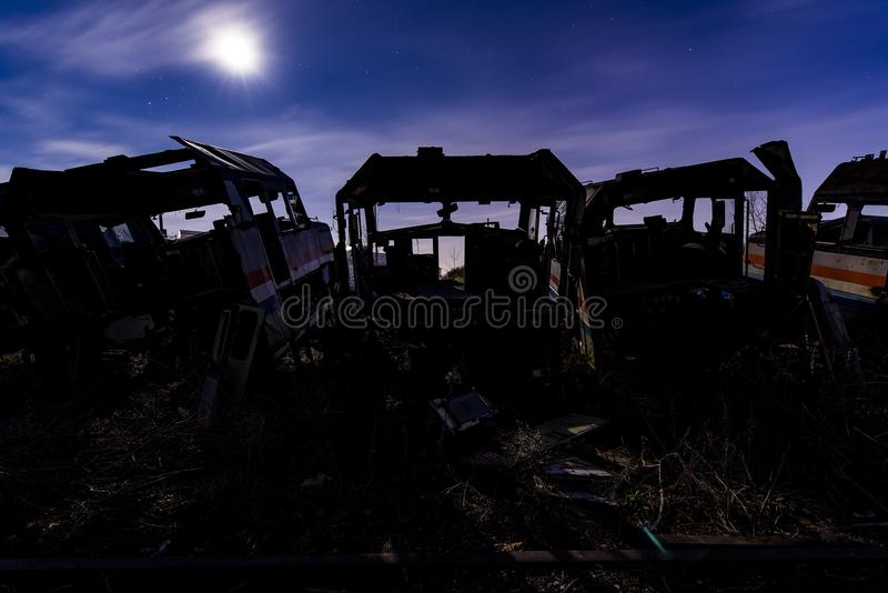 Amtrak Shell at Twilight - Abandoned Railroad Trains. A view of a derelict Amtrak shell at twilight at an abandoned train railroad yard in Ohio royalty free stock photography