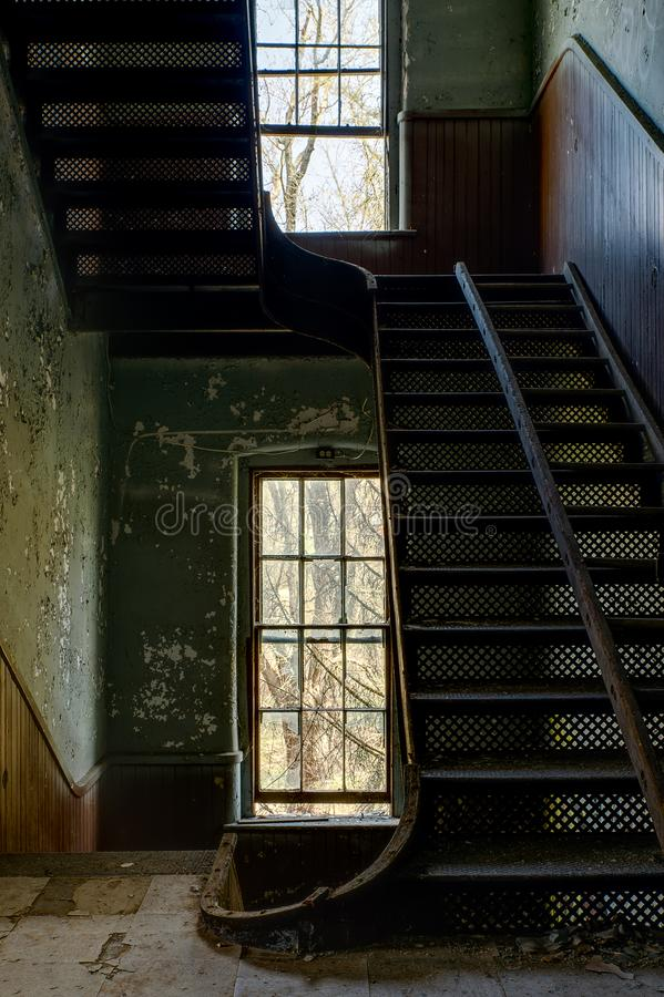 Cast Iron Staircase - Abandoned Knox County Infirmary - Ohio. A view of a derelict cast iron staircase at the abandoned Knox County Infirmary near Mt. Vernon royalty free stock photography