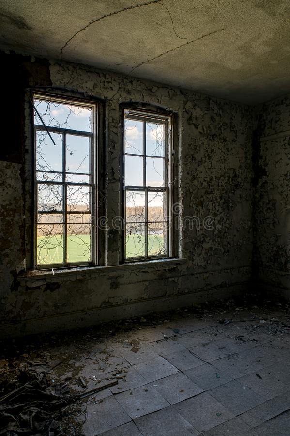 Derelict Room - Abandoned Knox County Infirmary - Ohio. A view of a derelict room at the abandoned Knox County Infirmary near Mt. Vernon, Ohio stock photo
