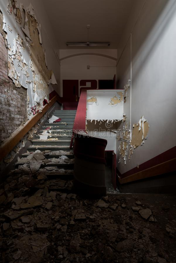 Derelict, Spooky Stairwell - Abandoned Gladstone School - Pittsburgh, Pennsylvania. A view of a derelict and spooky stairwell inside the abandoned Gladstone royalty free stock image