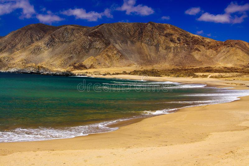 View on deserted secluded beach in dry harsh bare surrounding at pacific coastline. In Chile royalty free stock photography