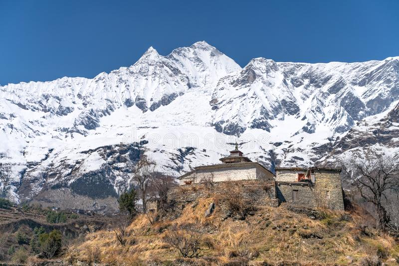 The view on Dhaulagiri peak and buddhist monastery. The photo was taken during my one year trip around Asia royalty free stock photos