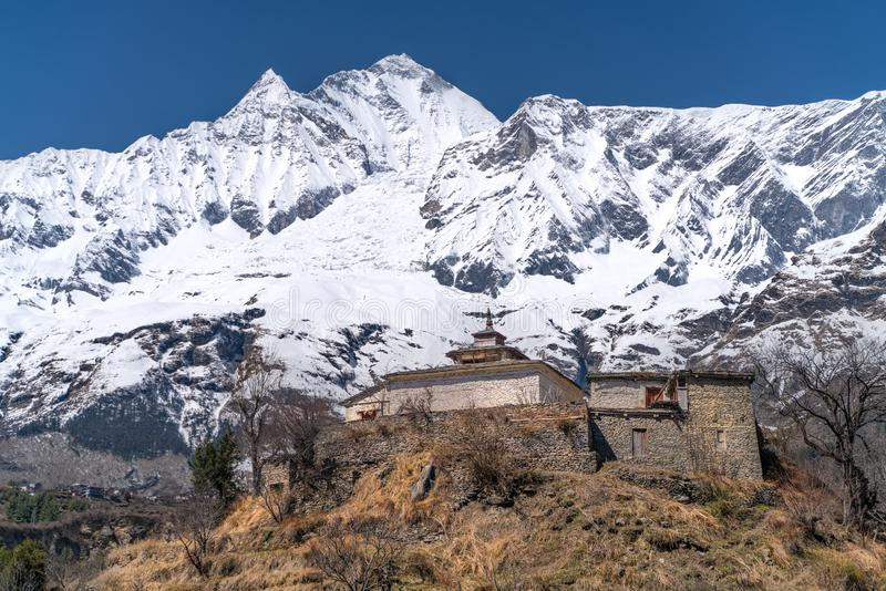 The view on Dhaulagiri peak and buddhist monastery. The photo was taken during my one year trip around Asia stock image