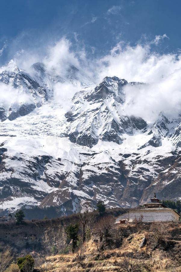 The view on Dhaulagiri peak and Buddhist monastery. The photo was taken during my one year trip around Asia stock photography
