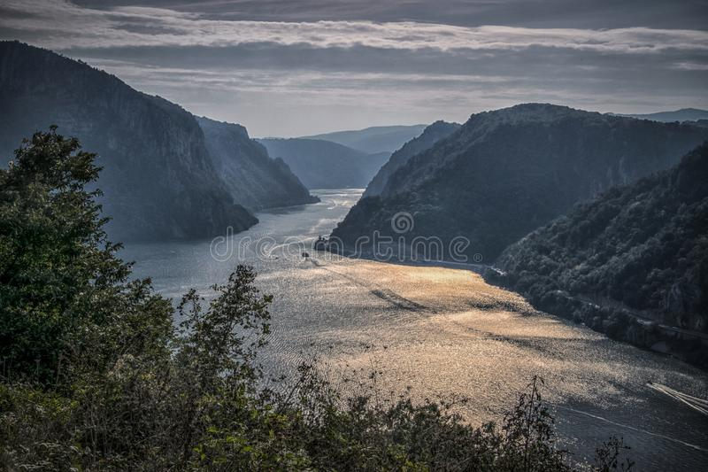 View of Djerdap gorge. View of Danube in Djerdap gorge from above with monastery Mraconia stock image