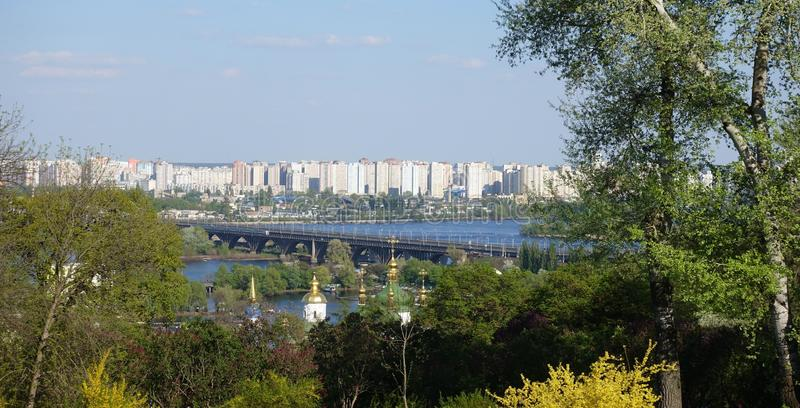 View of the Dnieper, the Paton Bridge and the Left Bank of Kiev on a sunny day stock image
