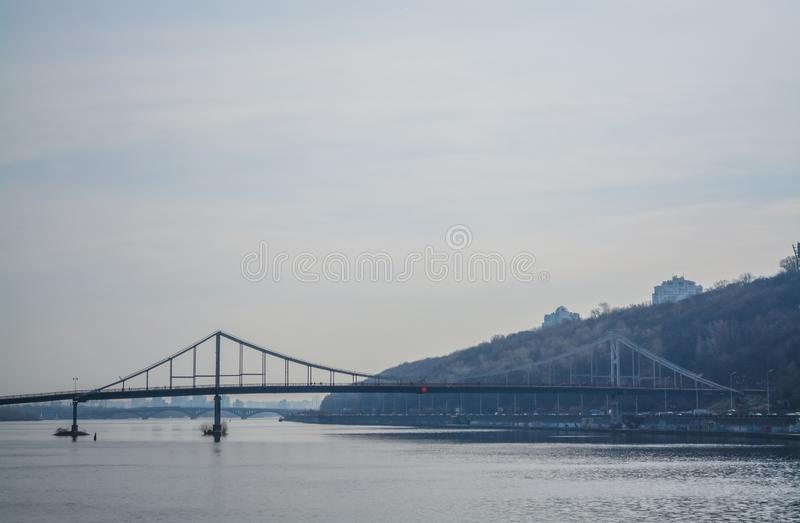 View of Dnieper river and the bridge from the coast of Kiev. Modern big city. Beautiful spring landscape.  royalty free stock image