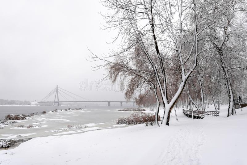 View of the Dnieper river during a cold and snowy winter day stock photos