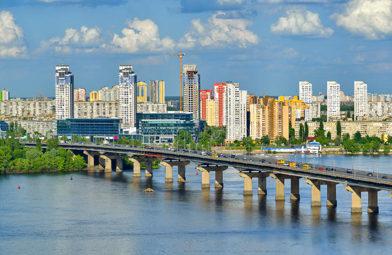 View of the Dnieper river in Kiev. Kiev city, Capital of Ukraine. View of the Dnieper river, Paton bridge and new buildings in Kyiv stock image