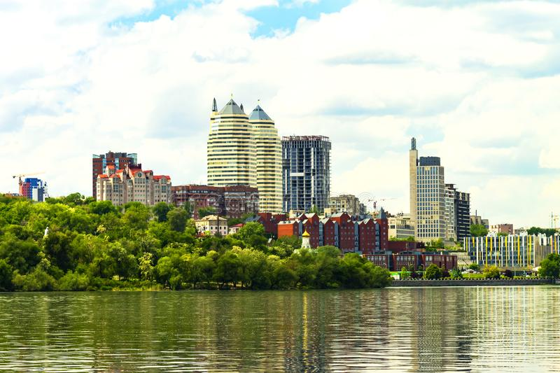 View of the Dnieper River, Monastery Island, buildings and skyscrapers of Dnipro city. View of the Dnieper River, Monastery Island, buildings and skyscrapers of stock image