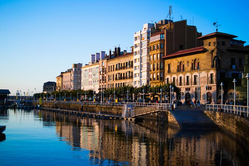 View of the dock of Gijon, Asturias, Spain, with reflections in the water, in Cimadevilla, the old town, during the sunset. royalty free stock photography