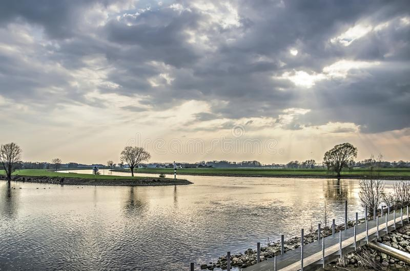 View from Doesburg waterfront. Dramatic skies over the IJssel river and the land beyond as seen from the waterfront of the town of Doesburg, The Netherlands stock photo