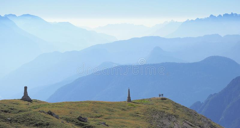 Mountain chains vanishing in the haze. View in the Dolomites, northern Italy over the craggy mountain chains. Influx of humid air after a clear weather period stock photography