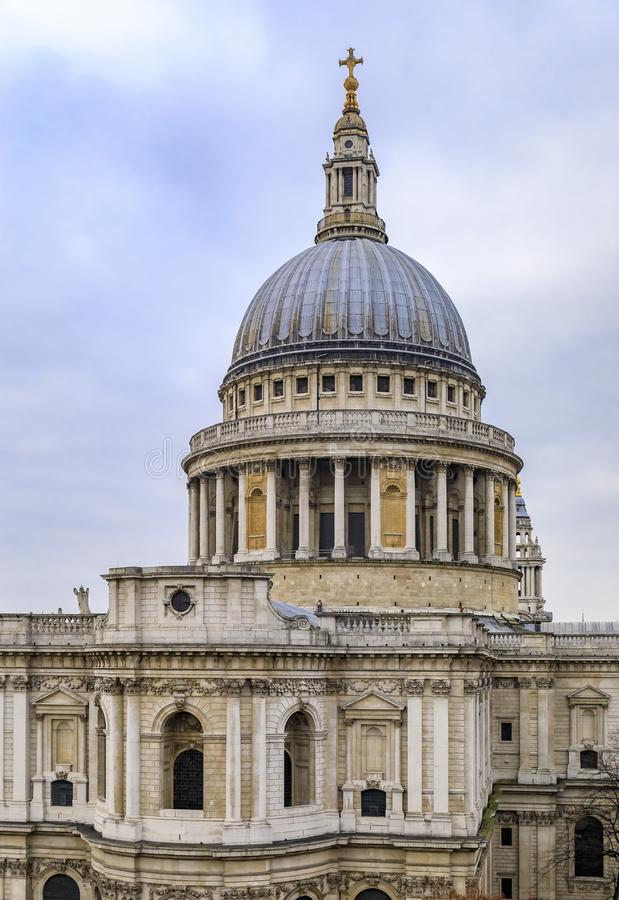 View of the dome of the famous St. Paul`s Cathedral in city center on a cloudy day in London, England. View of the dome of the famous St. Paul`s Cathedral in royalty free stock photography