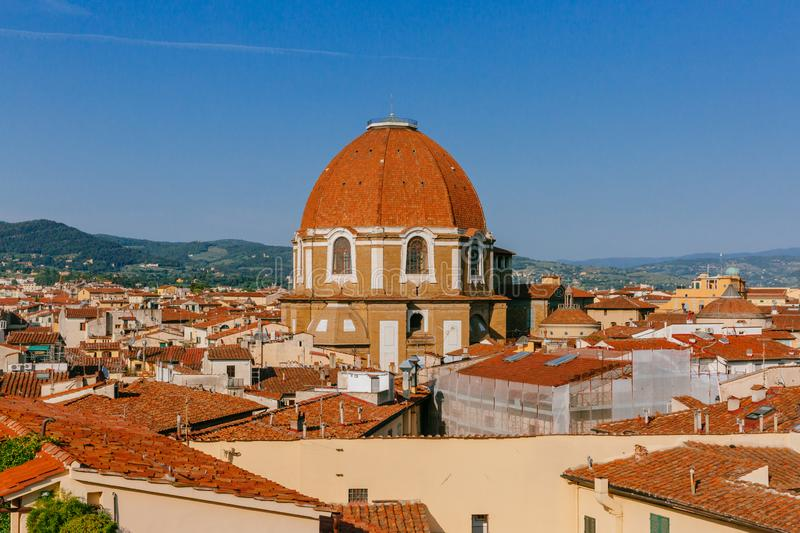 Dome of San Lorenzo Basilica under blue sky, over houses of the historical center of Florence, Italy. View of the dome of San Lorenzo Basilica under blue sky royalty free stock photo