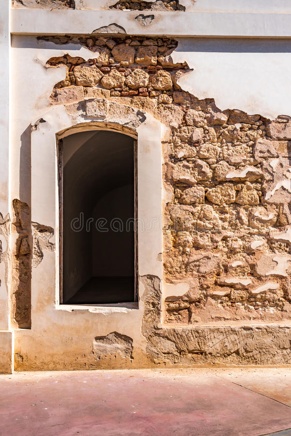 View of a doorway in Castillo de San Cristobal. With exposed stone and decaying plaster royalty free stock photo