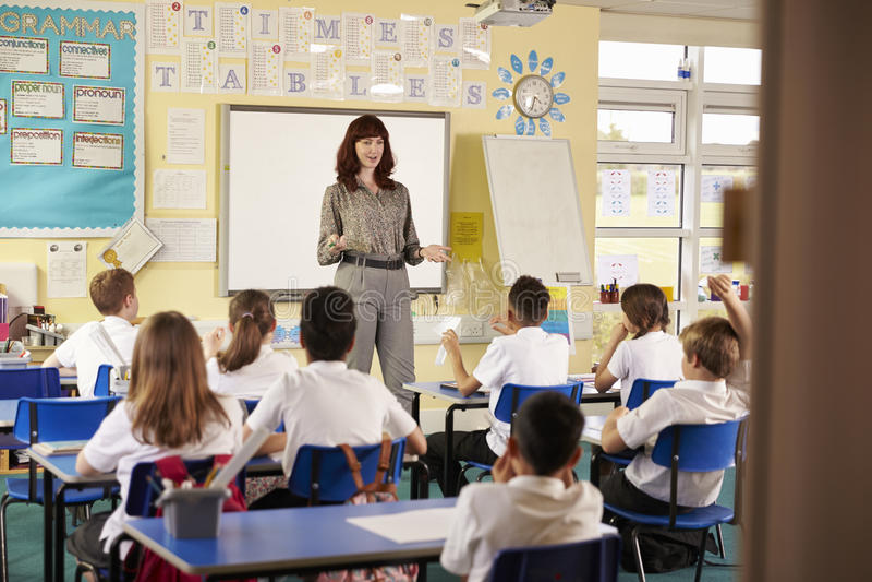 View from doorway of teacher taking primary school class stock image