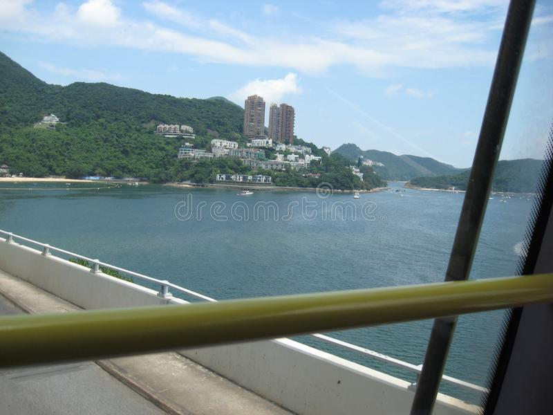 View from a double decker bus near Repulse bay, Hong Kong. The beautiful view from the top of a double decker bus near Repulse bay, Hong Kong stock image