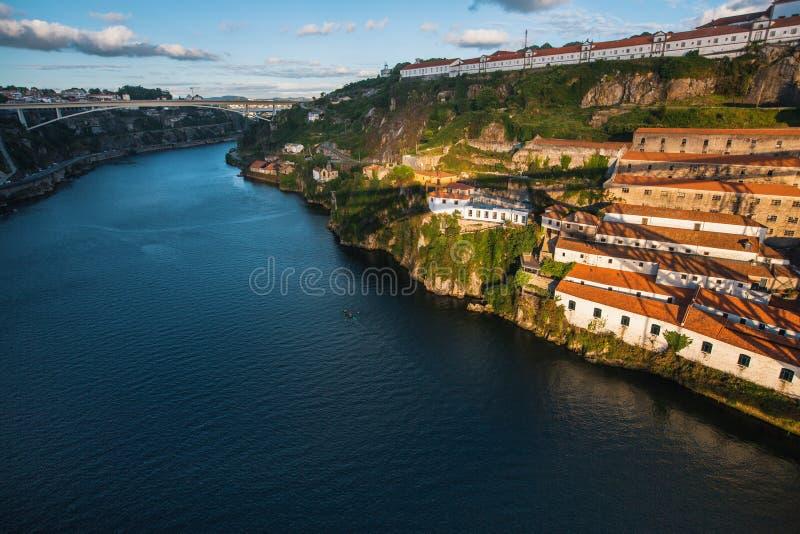 View of Douro river and the shore of Vila Nova de Gaia shot from Dom Luis I bridge, Porto. stock images