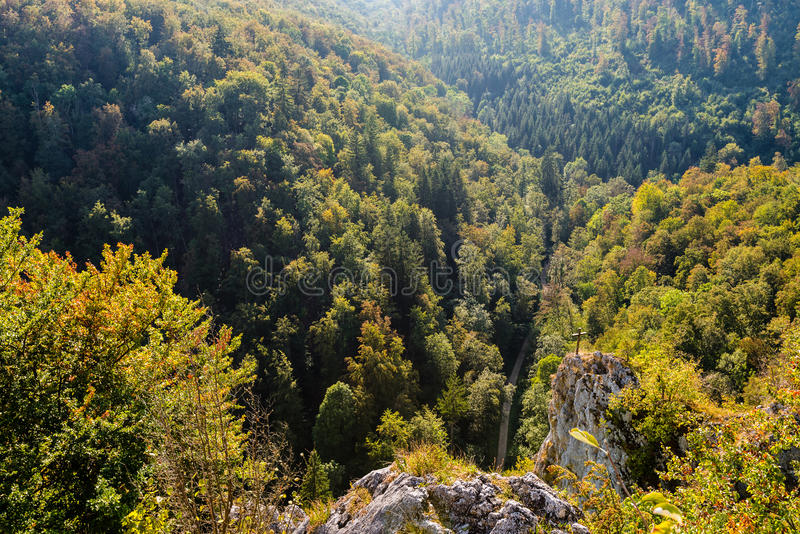 View down on beautiful landscape in Swabian Alb. View down the beautiful landscape of Laemmerstein (lamb stone) near the Wimsener Cove on a sunny autumn day in stock photography