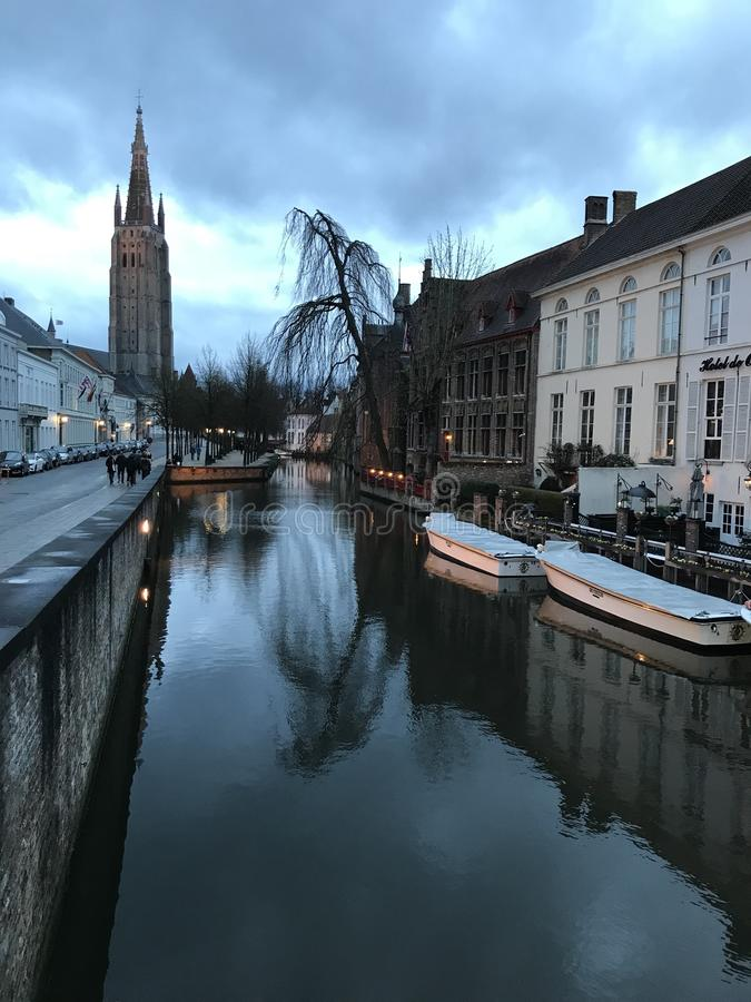 View down the Dijver Canal in Bruges. The Catholic Church of Our Lady, Bruges can be seen in the distance when looking down the Dijver Canal in Bruges, Belgium royalty free stock photography