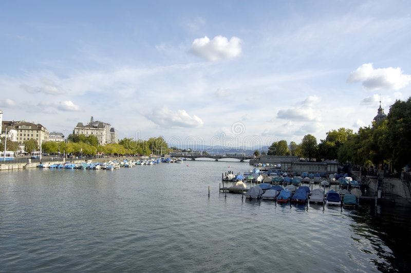View down river late afternoon. View down the main river through Zurich stock image