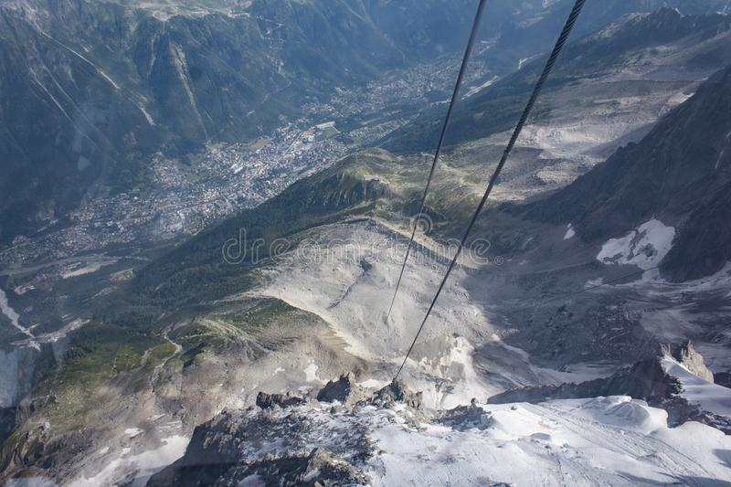 View down from ropeway to Aiguille du Midi. And view on Chamonix-Mont Blanc stock photos