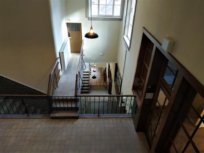 View down the staircase of an old industrial building. In Germany stock photography
