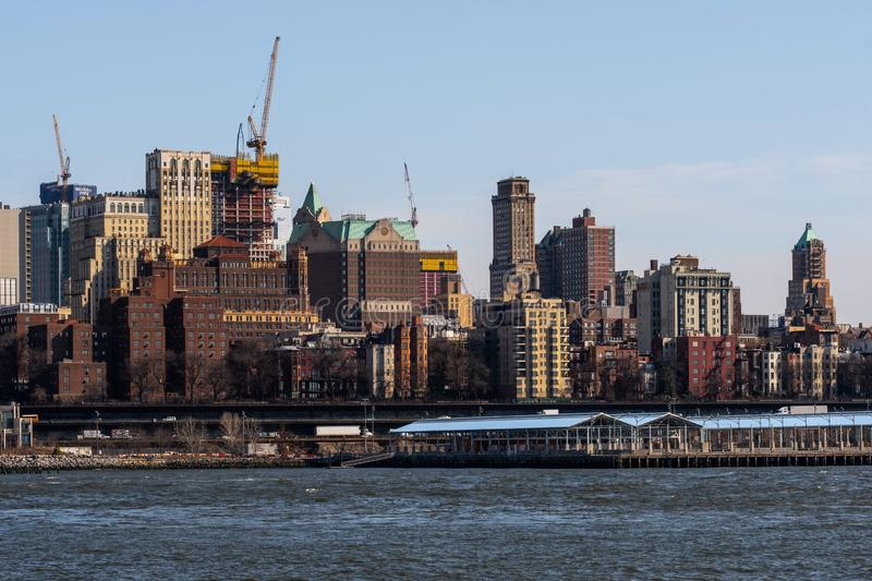 View down to Brooklyn Heights of skyscrapers from east river side in Lower Manhattan New York City royalty free stock image