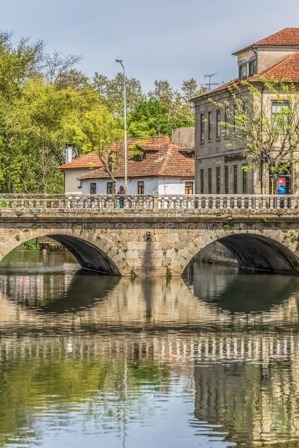 View of the downtown area of Viseu with Pavia river. Viseu / Portugal - 04 16 2019 : View of the downtown area of Viseu with Pavia river and banks with buildings royalty free stock photos