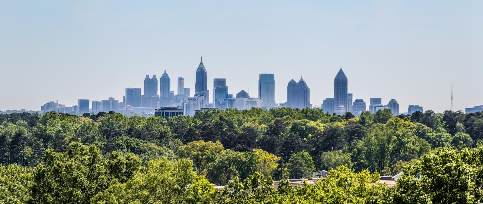 A view of the downtown Atlanta skyline from Buckhead. Downtown Atlanta Skyline showing several prominent buildings and hotels under a blue sky as seen from royalty free stock images