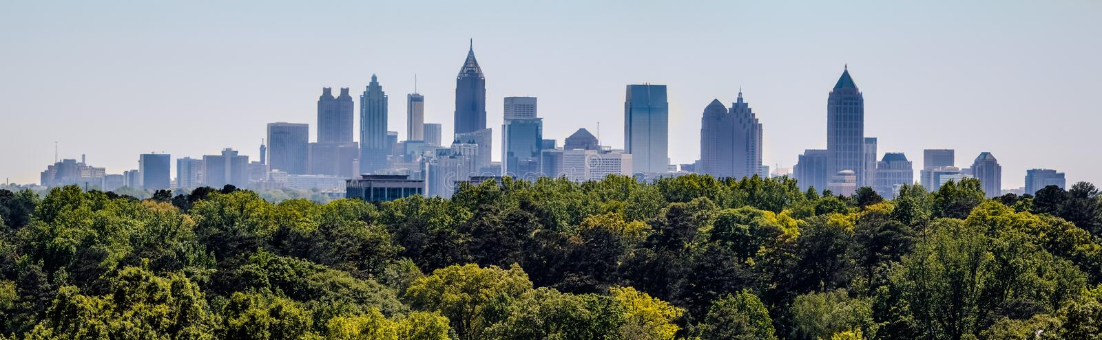 A view of the downtown Atlanta skyline from Buckhead. Downtown Atlanta Skyline showing several prominent buildings and hotels under a blue sky as seen from royalty free stock image