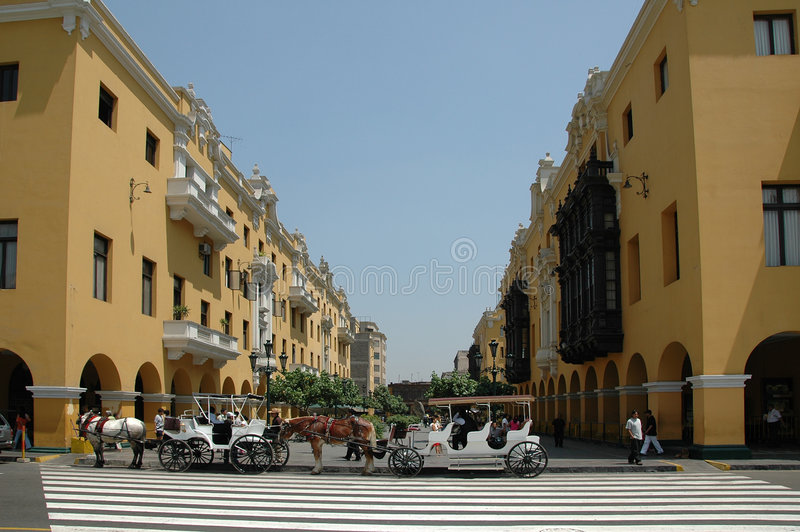 View of downtown Lima Peru wit. H wagons and horses stock photography