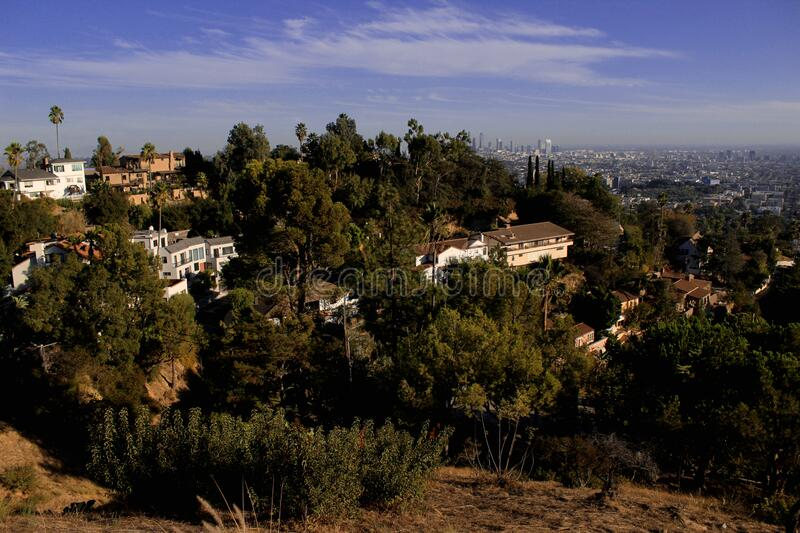 A view of downtown Los Angeles through a residential area of ​​Los Feliz off the mountain at Griffith Park. USA, California. October 2016 royalty free stock photography
