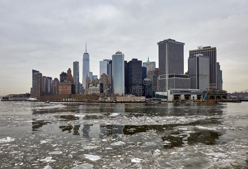 View of downtown New York in winter from the sea. View of downtown New York in winter, ice floating in the foreground royalty free stock photography