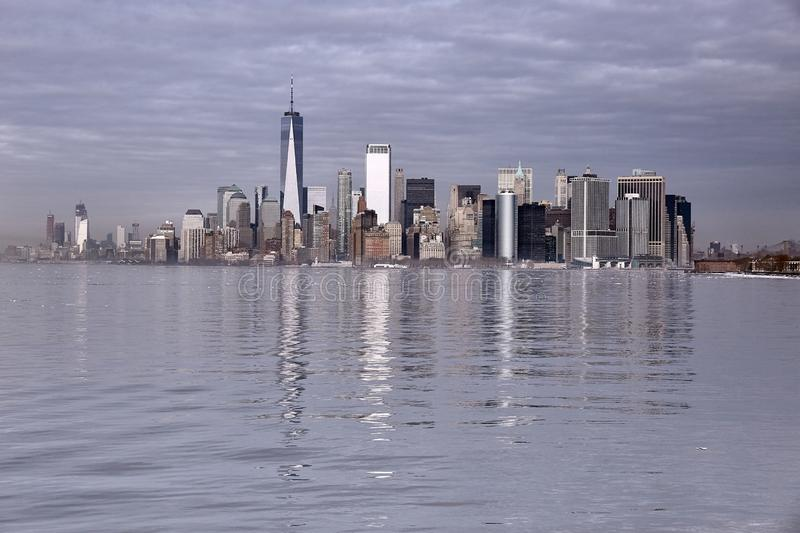 View of downtown New York in winter from the sea. Reflections of buildings on the sea stock photography
