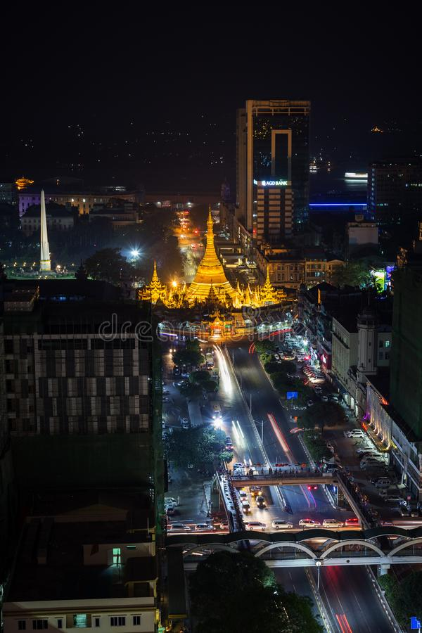 View of downtown Yangon from above at night. Downtown, Sule Pagoda Road and lit Independence Monument and Sule Pagoda in Yangon, Myanmar, viewed from above in royalty free stock photos