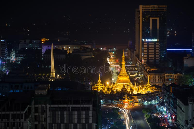 View of downtown Yangon from above at night. Downtown, Sule Pagoda Road and lit Independence Monument and Sule Pagoda in Yangon, Myanmar, viewed from above in royalty free stock photography