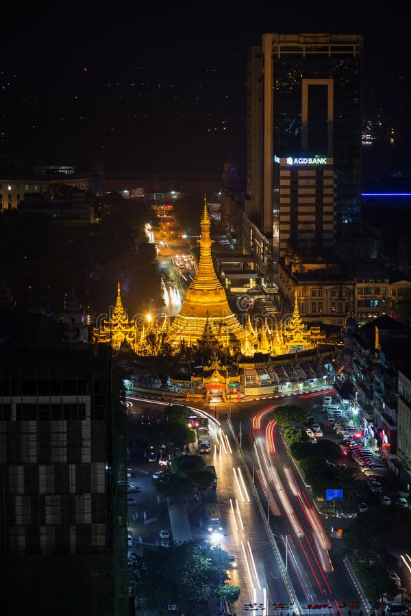 View of downtown Yangon from above at night. Downtown, Sule Pagoda Road and lit Sule Pagoda in Yangon, Myanmar, viewed from above in the evening stock images