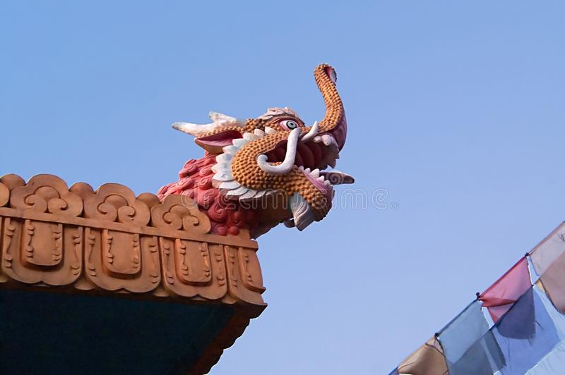 View of dragon head and colour flags royalty free stock photography