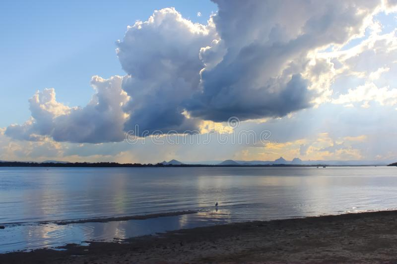 View of dramatic clouds and early sunset looking from Bribie Island over the Pumicestone Passage to the Glass Mountains in Queensl stock photography