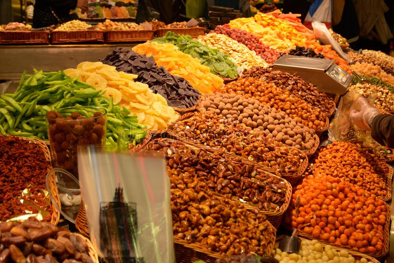 View of dried fruit and nuts at market in Barcelona royalty free stock images