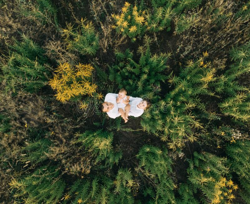 View from the drone to the happy family with baby stock images
