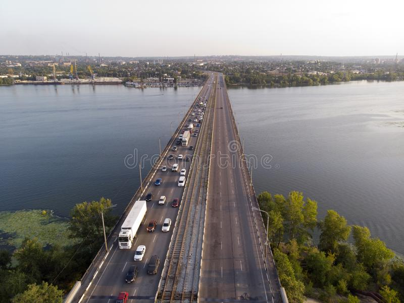 View from the drone to heavy traffic on a bridge over a river stock image