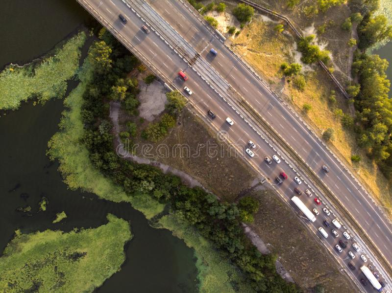View from the drone to traffic on a bridge over a river. With a view above stock photos