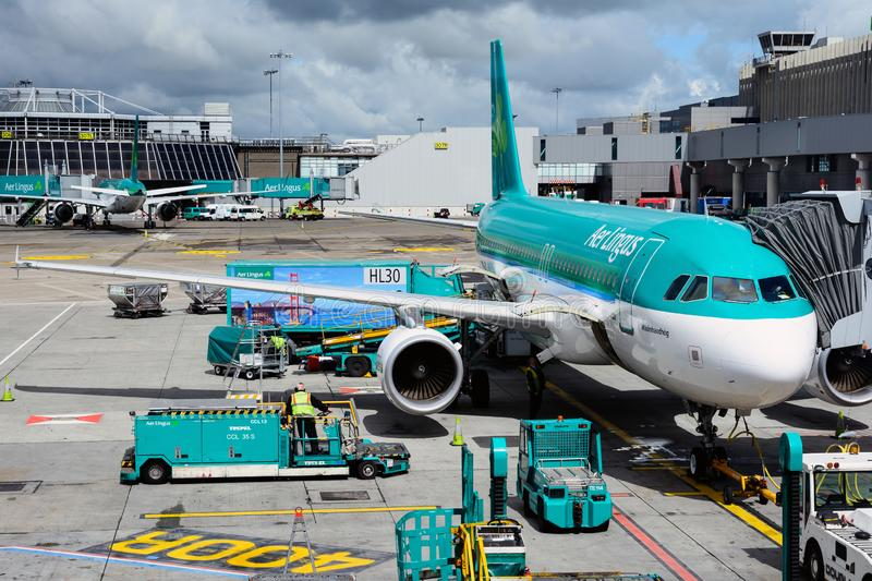 View of Dublin airport apron and Aer Lingus airbus from passenger terminal royalty free stock image